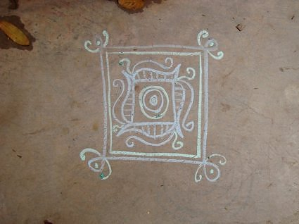 rangoli made with moist chalk sticks.