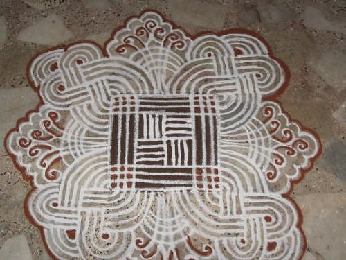 Kolam rangoli alpana design with lines and flowers