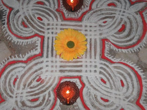 Diwali rangoli using moist chalk and kumkum