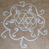 A simple star based kolam rangoli design in chalk